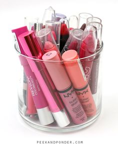 Display your lip products in an empty candle jar!...colorful display of pretty pout perfecters.