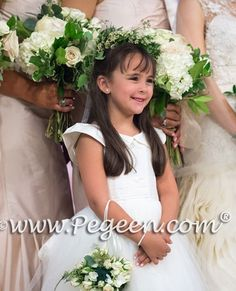 A beautiful champagne wedding colored bridesmaids dresses with the sweetest of flower girls.  See the full wedding at pegeen.com   👗Style 981 ...........................................................⁠ Did you know that we have over 200 silk colors to work with starting at $99?⁠ ⁠ #flowergirldress  Click the link to get more info on this fully customizable flower girl dress and all of its options.⁠ ...........................................................⁠ Contact us today at (407) 928-2377