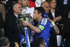 Frank Lampard of Chelsea celebrates with the trophy after their victory in the UEFA Champions League Final between FC Bayern Muenchen and Chelsea at the Fussball Arena Muenchen on May 2012 in Munich, Germany Sport Icon, Uefa Champions League, Chelsea Fc, Victorious, Hot Guys, Soccer, Baseball Cards, Marketing, Celebrities