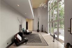 Windows and natural light. The rug is the perfect piece for this décor.