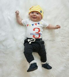 FREE shipping in the USA 3 month baby milestone outfit. Gender neutral for boys and girls. Liv & Co.™ brings you the best in baby bodysuits & t shirts for babies, kids, & adults and this 3 month baby one piece bodysuit is just the staple your child needs in his or her 3 month photographs! In primary / circus themed colors of red, yellow, & blue, this bodysuit is part of a series of bodysuits I've designed that can be made from 1 month old all the way up to 12 months old.