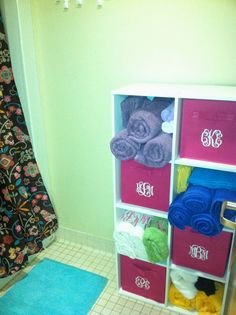 Use stackable cubes for bathroom storage - How To Survive Your Dorm Bathroom. Great idea for a four person suite!