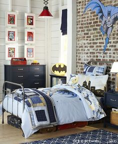 @ Missy Mecum  whenever I see the framed comic books on the wall I think of Isaac's superhero bedroom =)  So cute!