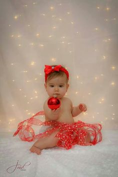 Simple... ribbon, ornaments, and lighted background. #christmas #baby #christmasportrait #babysfirstchristmas #babygirl