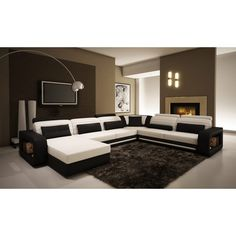 The 1005C contemporary black and white leather sectional sofa presents a U-shape…