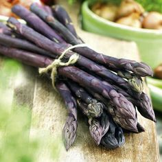The Purple Passion is a fun and colorful asparagus to grow. This dark purple asparagus plant is a perennial that can be planted just once and the succulent spears can be enjoyed for years. A very nutritious and delicious vegetable to have in your garden. Asparagus Garden, Asparagus Seeds, Asparagus Roots, Perennial Vegetables, Types Of Vegetables, Planting Vegetables, Growing Vegetables, Purple Vegetables, Growing Asparagus From Seed