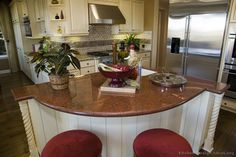 #Kitchen Idea of the Day: Semi-circular island with red granite on antique white cabinetry.