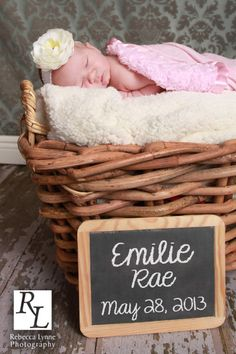 Newborn girl picture in basket, added a little chalkboard.  Decided to use a chalkboard-like font to add in her name and date of birth later.