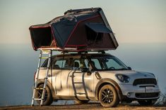The new iKamper Skycamp Mini two-person rooftop tent could be a fit for just about any four-wheeled adventuremobile. It offers up the crucial features of both hardshell and softshell rooftop tents: lightweight, compact, and easy to deploy and put away. Rooftop Tent Camping, Truck Bed Camping, Camping Glamping, Roof Rack Tent, Roof Top Tent, Small Suv, Small Cars, Mini Cooper Custom, Sleeping Tent