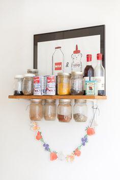 Spice storage with  mini jars attachef to board. Danielle's Bright & Multi-functional Top Floor Apartment
