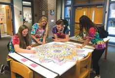 An oversized coloring sheet at Cellucci's library offered students a chance to relax during finals in May and June. Photo courtesy of Westborough High School library School Librarian, Library Displays, Year 2016, Coloring Sheets, Libraries, Finals, High School, Students, June