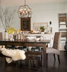 Warm accents and homey accessories make this welcoming dining room by Tin Barn Market a favorite among Pinterest users.