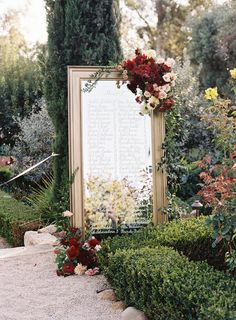 a mirror and white calligraphy serve as a seating display | Photography: Braedon Photography