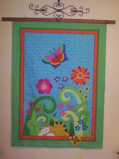 from Quiltopia.  http://2.bp.blogspot.com/-qgbDRshp_mg/TetOS81roNI/AAAAAAAAAdM/recP0Y83rCM/s1600/Baby+quilt+1.jpg