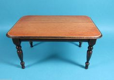 Cindy Malon - partially stained table is constructed with a distressed top and turned legs. Tabletop has rounded ends.sold on ebay for $152.50