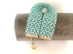 Items similar to Aztec Bracelet Woven on a loom Bracelet seed beads Turquoise brown Metallic Cuff sleeves Gift for her Wide womens girls Choice of colors on Etsy Loom Bracelet Patterns, Peyote Stitch Patterns, Bead Loom Bracelets, Etsy Jewelry, Beaded Jewelry, Tear, Geometric Jewelry, Bijoux Diy, Diy Jewelry Making