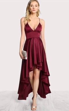 Draw admiring glances in this gorgeous short cami dress with deep V-neck. This short party dress features a sleeveless bodice with an eye-catching deep V-neckline secured with a sheer inset panel, enticing illusion panels on the sides, flirty open V-back, a short asymmetrical skirt that whimsically flares out at ankles.