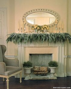Dripping crystal icicles dangle from a cedar-covered, snow-dusted mantelpiece to create a frosty scene. Soft powder, looking as if it floated down the chimney overnight, drifts around stacked wood and iron urns filled with silvery santolina.