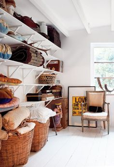 shelves with baskets and linens