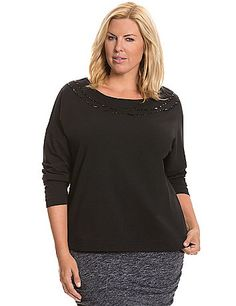 Embellished with two rows of stone along the boat neckline, this flattering long sleeve top is a fashion-savvy staple. Versatile for dressing up or down, this soft knit top takes you anywhere. lanebryant.com  $19.99 02/01/2015