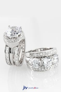 Sparkle like a winter wonderland in Bella Luce rings this Christmas! || Bella Luce (R) 9.54ctw Round And Baguette Rhodium Plated Sterling Silver Ring With Bands and 5.42ctw Rhodium Plated Sterling Silver Ring With Guard
