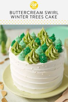 Turn a plain iced cake into a winter oasis with this Happy Little Trees Cake. Use various shades of green icing and open-star piping tips to pipe trees, then sprinkle nonpareils on the trees to make it look like a fresh coat of snow. A wonderful cake to make for a December birthday or Christmas gathering with friends and family, this simple winter cake brings the beauty of the season into your home. #wiltoncakes #buttercreamcakeideas #cakeideas #christmascake #wintercake #holidaycake
