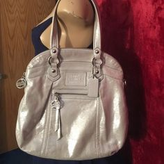 WOW!!!RARE Coach Poppy Leather Highlight Foldover Leather  • Inside zip, cell phone and multifunction pockets  • Zip-top closure, fabric lining  • Outside zip pocket  • Detachable strap for shoulder or crossbody wear  • Handles with 7 in. drop  • 14 in. (L) x 13.25 in. (H) x 4.25 in. (W)  Design to stand tall or fold over, you choose! Take advantage of reasonable Buy NOW price!  Good condition, there are a couple light marks to outside and some light staining to top rim of liner. Coach Bags…