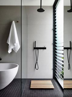 5 Bathrooms with black floor tiles