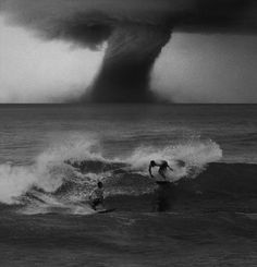 Who surfs during a twister AND they're dropping in on each other?