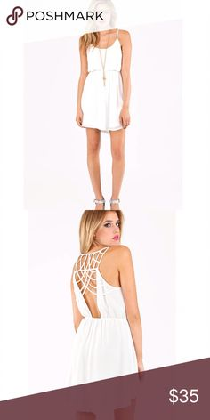 """White Tobi Dress White Lattice Tobi Dress.  Fully lined with beautiful Back detailing.  100% Polyester, elastic waist, length 33"""".  Worn once, in excellent condition! Tobi Dresses"""