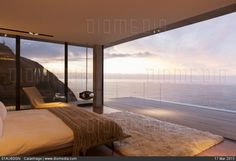 STOCK IMAGE - Modern bedroom overlooking ocean by www.DIOMEDIA.com