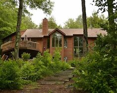 Enjoy the deck by the water's edge; anchor your boat at the private dock; soak in the hot tub; have a glass of wine on the private master suite deck; unwind in the sauna; and/or lounge in the hammock. Could you ask for more? Sitting on nearly two acres in Hinsdale, the four-bedroom, three-and-a-half bathroom home has an open floor plan with views of Lake Ashmere from every room. The studio above the garage, with its own private deck, makes a great home office or playroom.