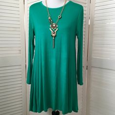HP Long sleeve green stretch knit swing dress So cute and flirty! Lightweight knit in a gorgeous green (almost teal). Perfect amount of stretch. Scoop neck, long sleeves. No size tag, but in my opinion, will fit a small or medium. (Dress form is a size 4, for reference.) NWT; never even tried on. Buzy Collection Dresses Long Sleeve