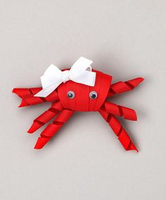 Whimsy and cheer come together on this sweet crab clip that's complete with a contrast bow. Handmade and carefully crafted with sealed ends to prevent fraying, this happy-go-lucky piece will brighten any 'do.Approx. 2'' W x 2'' HGrosgrain ribbonImported