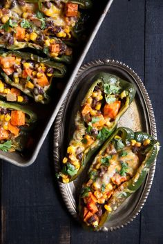 Vegetarian stuffed poblano peppers loaded with salsa, sweet potato, corn and black beans. Easy, minimal ingredients and HEALTHY! | ambitiouskitchen.com