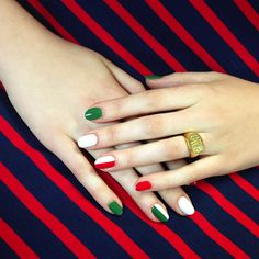 """I love designs that you might not see from one angle, but you can from another,"" says Poole of the green, white, and red stripes that form the Italian flag when the fingers are interlaced. Sally Hansen Red My Lips and Marc Jacobs Jungle are separated by Chanel Eastern Lights."