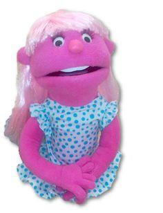 Títere niña de 50 cm, color rosa fuerte, con dientes, vestido de color blanco con lunares celeste pequeños, cabello de lana tricolor, lazo blanco. (código NA-28)