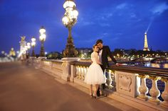 Cecile & Kevin snuggle up in Paris. Cecile wears our Pearly Queen wedding dress. maries-of-a-paris-tour-eiffel (40)