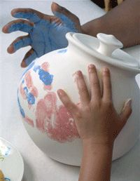 Color Me Mine ceramics painting for kids- love the idea of using their hands for the pattern