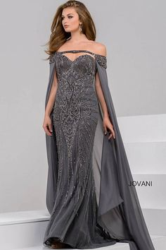 Gorgeous floor length form fitting fully beaded charcoal evening gown features off the shoulder straight neckline with long chiffon cape.