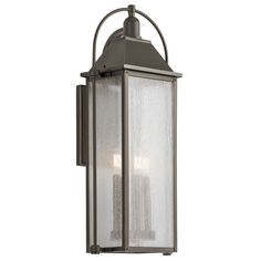 This four-light outdoor wall lantern from the Harbor Row collection has an updated traditional design inspired by classic carriage lanterns, featuring a clear, seeded glass for a highly textured appearance and brass candle accents for a warm glow. Outdoor Wall Lantern, Outdoor Wall Sconce, Outdoor Wall Lighting, Exterior Lighting, Outdoor Walls, Outdoor Spaces, Lantern Lighting, Cottage Lighting, House Lighting