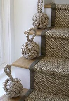 Knot decor on stairs and carpet runner. Runners available at www.naturalarearugs.com. Choose any size, design and binding color.