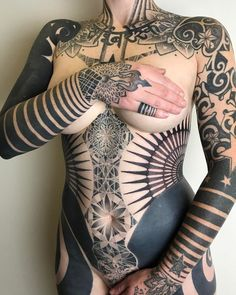 Awesome full body blackork&dotwork tattoo for women. Love it!
