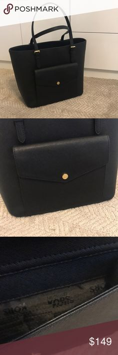 """Michael Michael Kors Jet Set Black Leather Tote Michael Michael Kors Jet Set Black Leather Tote. NEW WITH TAGS! NO TRADES! Open top Exterior features gold-tone hardware.  Interior features center zip divider pocket-padded, 1 zip pocket 3 open pockets, 1 cellphone pocket.  15-1/2"""" W x 11"""" H x 6"""" D Saffiano leather MICHAEL Michael Kors Bags Totes"""