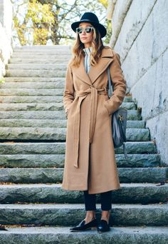 black hat, tort sunglasses, striped mock neck top, wrap camel coat, cropped jean and loafers #style #fashion #winter #belted