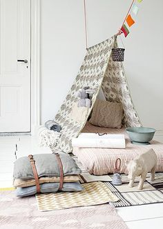 For the bonus room: Instead of a teepee, hang strong rope and either wooden dowel or rod from the ceiling, then choose fabric, little heavier, and add cushions.