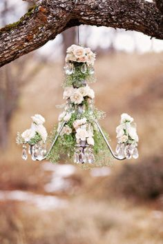 Chandeliers, candles, and flowers.  Just happening upon a wedding in a forest clearing.  Romantic and rustic, with understated elegance.