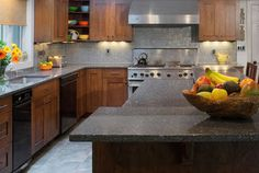 What are suitable cabinet colors for grey granite countertops? This is a common question as many people choose the elegance of dark countertops. Green Kitchen Countertops, Grey Granite Countertops, Recycled Glass Countertops, Grey Kitchen Cabinets, Granite Kitchen, Countertop Options, Gray Granite, Glass Kitchen, Laminate Countertop