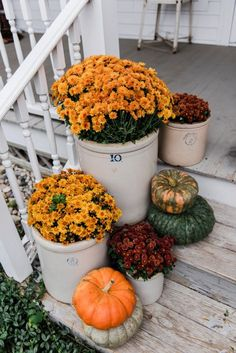 Rustic Fall porch - Mums in crocks to give a farmhouse porch an instant fall vibe. Great source for farmhouse decor.Cozy Rustic Fall porch - Mums in crocks to give a farmhouse porch an instant fall vibe. Great source for farmhouse decor. Easy Home Decor, Cheap Home Decor, Porch Decorating, Decorating Your Home, Decorating Ideas, Decorating Websites, Rustic Decor, Farmhouse Decor, Rustic Style