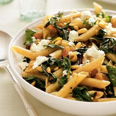 This low-cholesterol dish combines whole-wheat penne pasta with vitamin K-packed Swiss chard. The mixture of golden raisins, jalapeño, and pine nuts adds a surprising (and delicious) spice, sweetness, and crunch. Don't like the feta cheese? We think goat cheese would be yummy, too! #nutrition | health.com